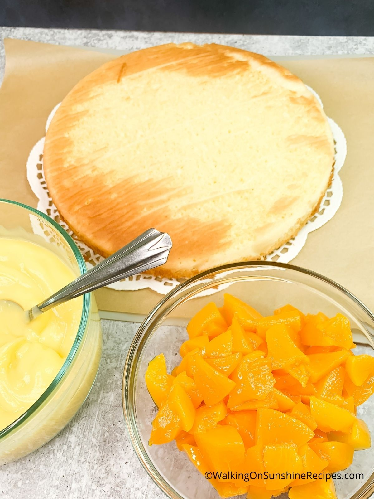 baked cake with pudding and peaches.