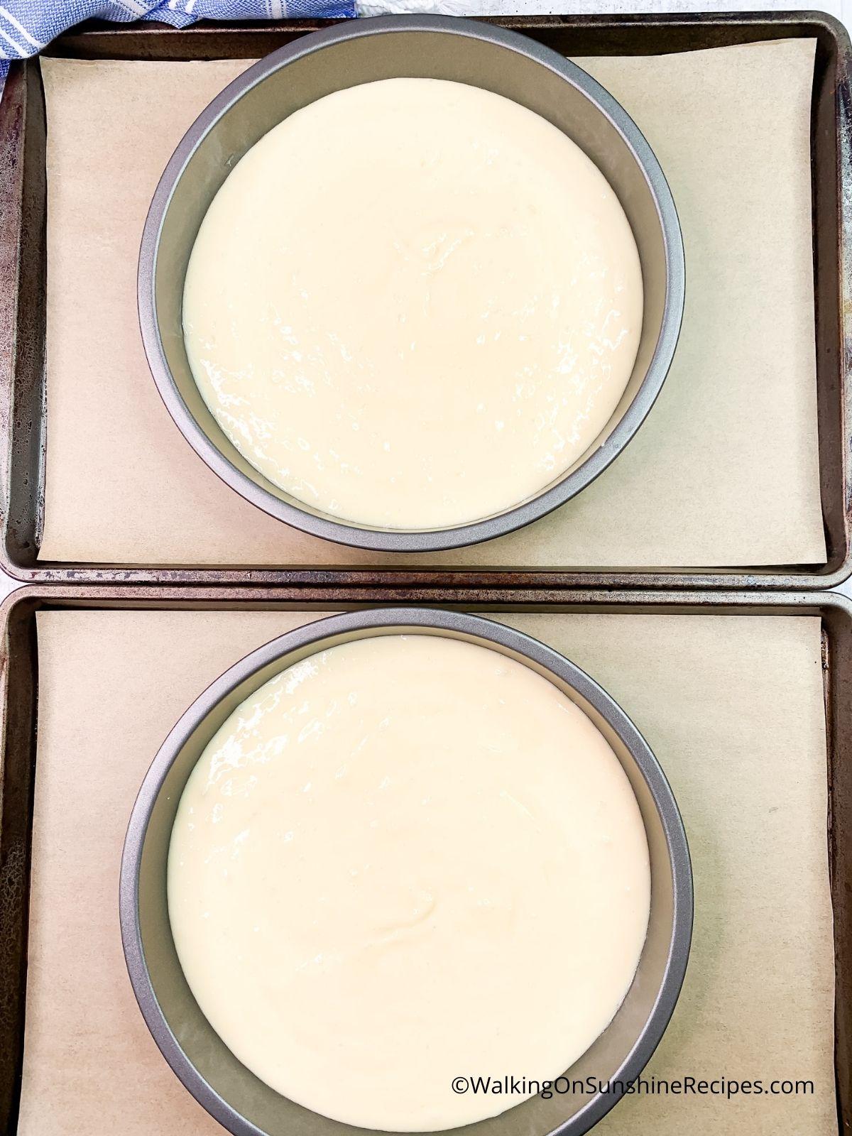 cake batter in pans before baking.