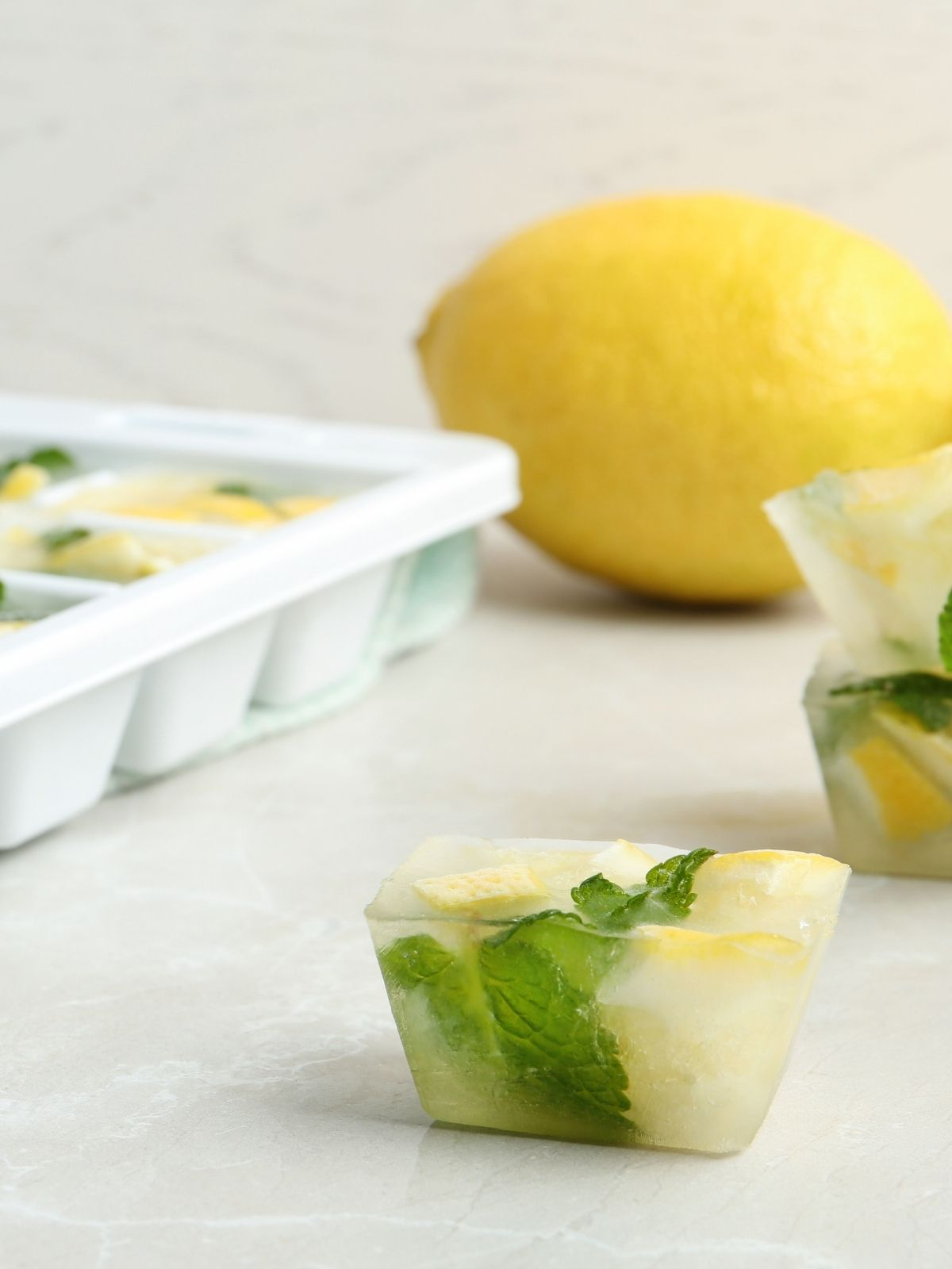 ice cubes with lemon slices.