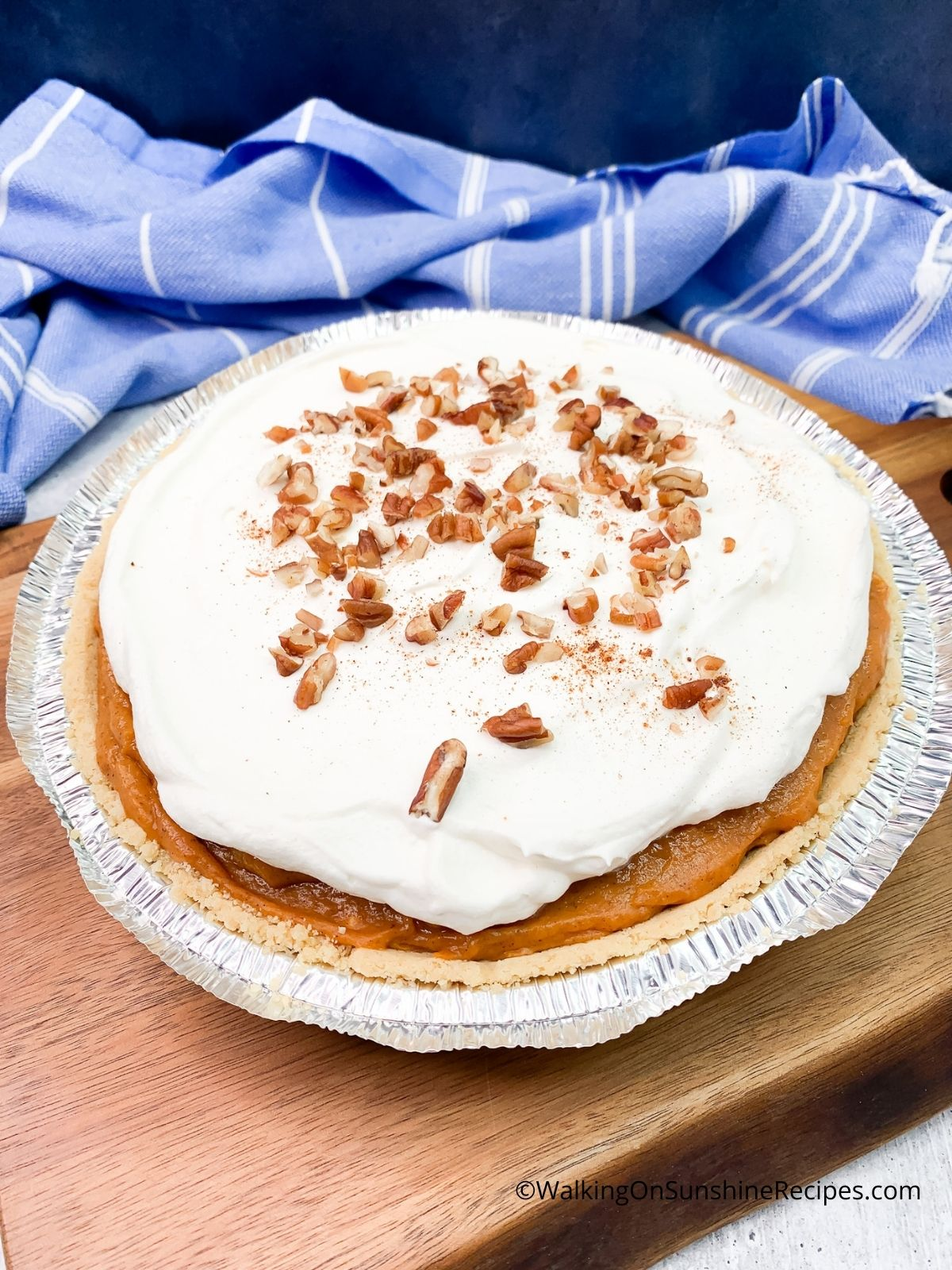 pumpkin cheesecake with chopped pecans on top.