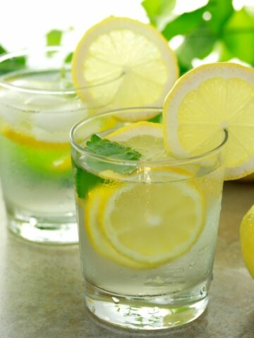 glasses of water with lemon slices.