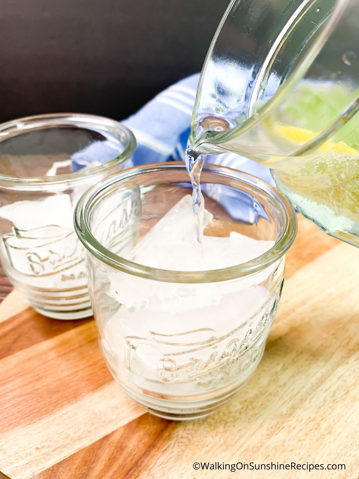 Pouring lemon lime sparkling water.