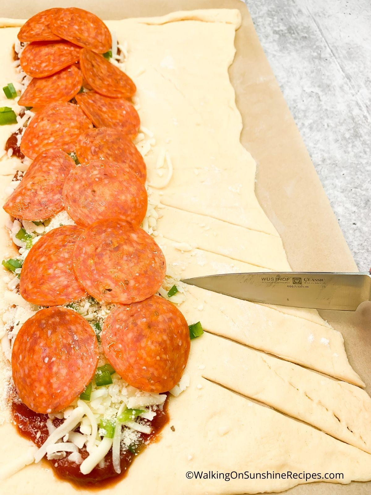 Make slices in crescent dough.