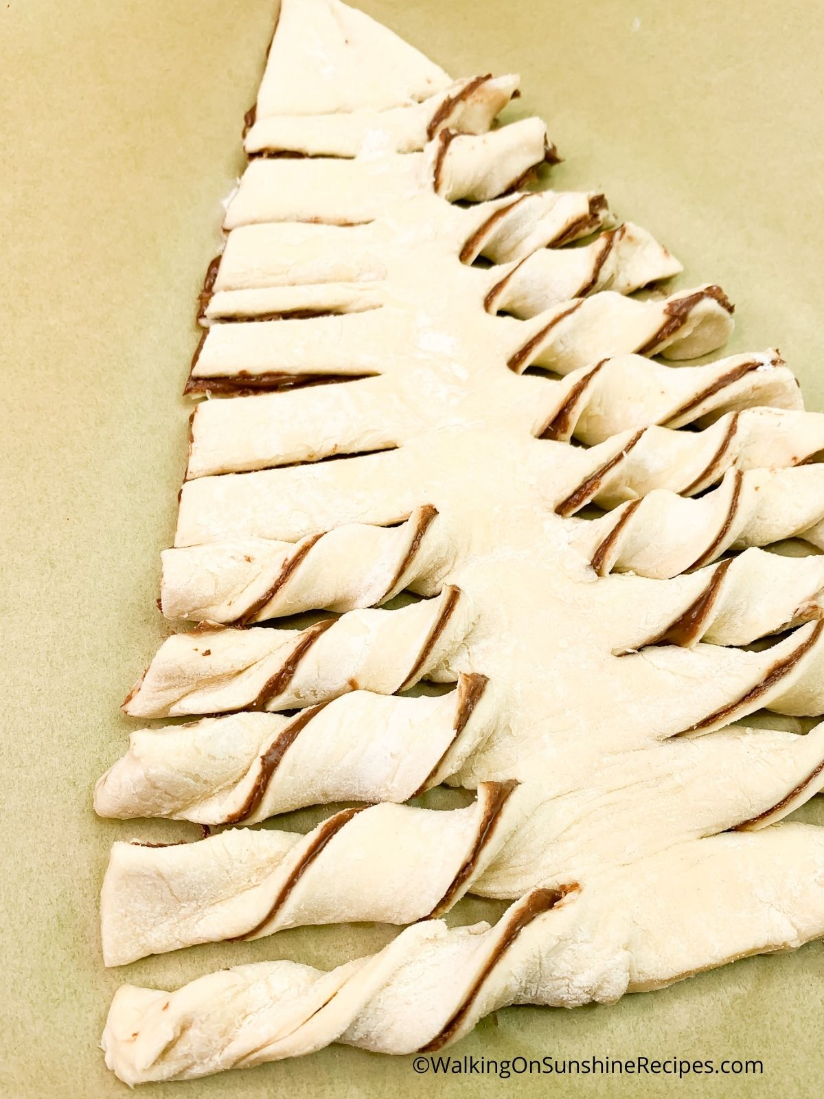 Twist Nutella puff pastry xmas tree branches.